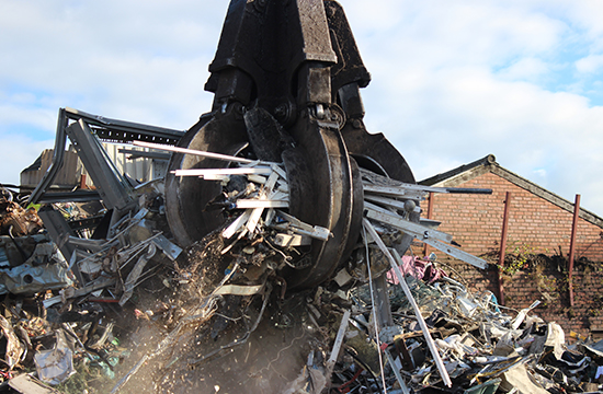 Scrap metal being cleared after a factory clearance