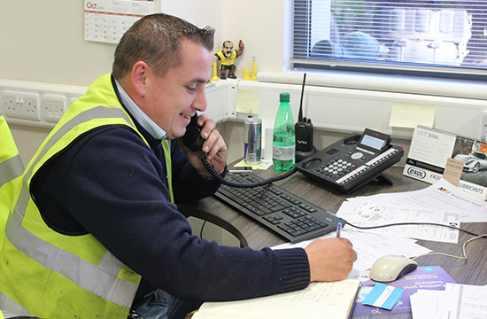 A member of the Morecambe Metals team on the phone consulting about a factory clearance