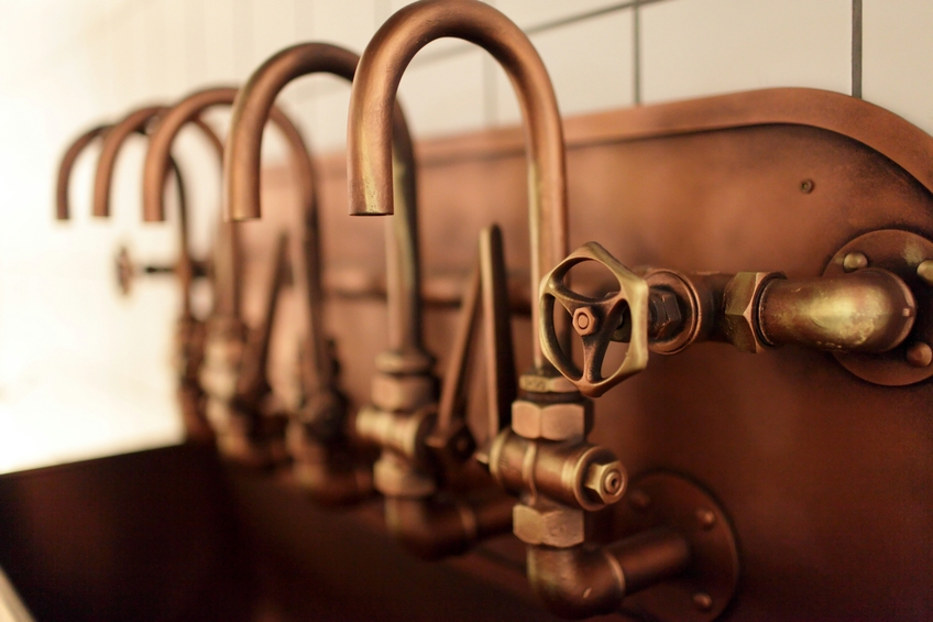 The copper taps on an old brewery