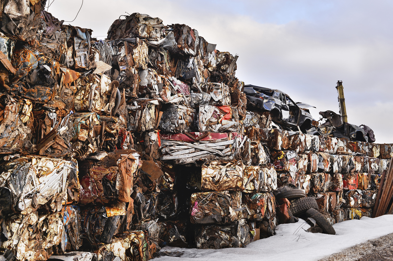 A pile of compressed cars in blocks for processing