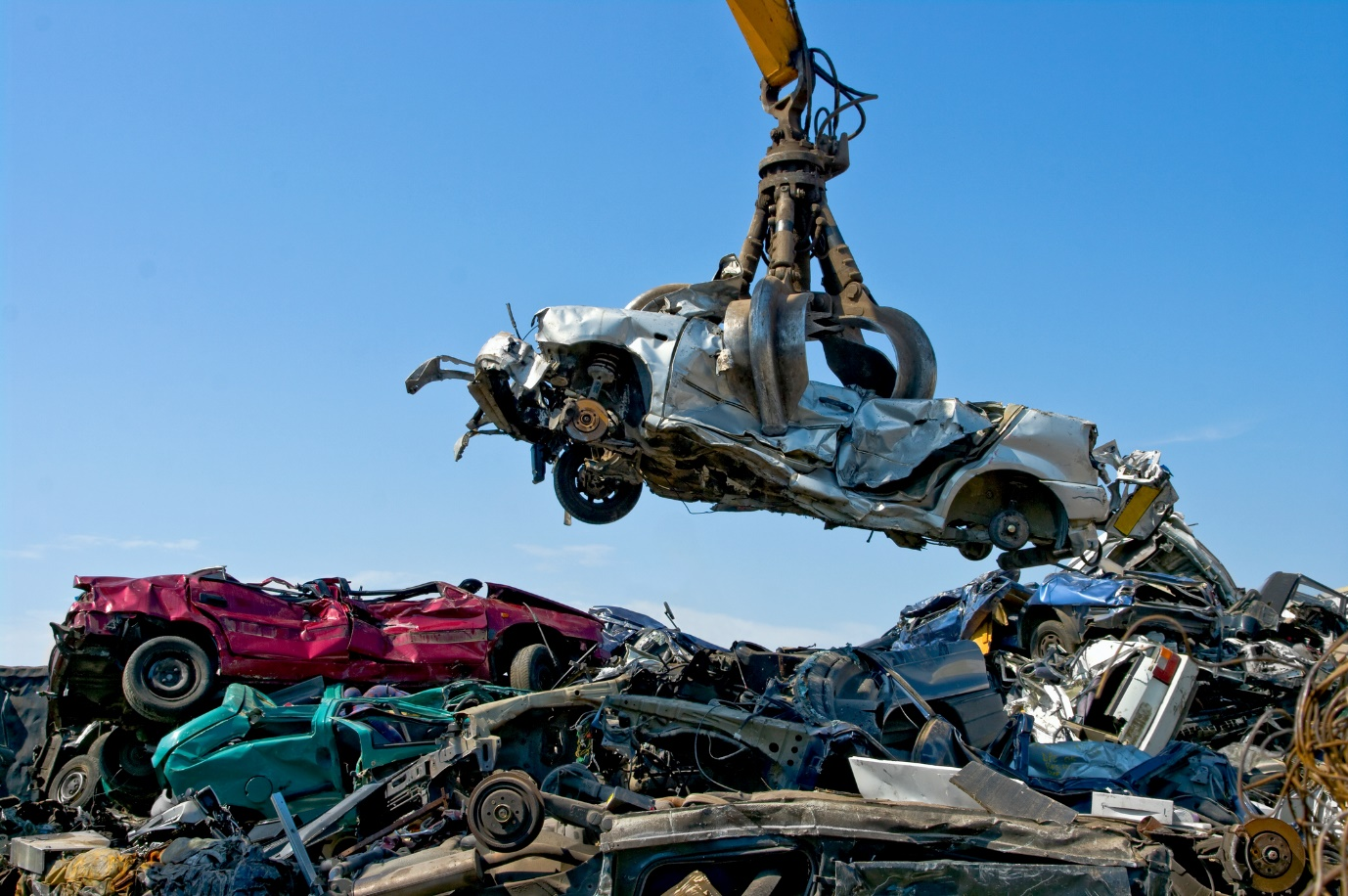 car in scrap metal yard